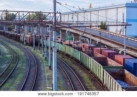 Cargo station with trains and trucks in big sea terminal