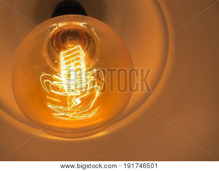 Vintage glowing light bulb, Close up and selective focus (light bulb, light, lamp)
