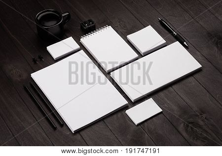 Blank corporate stationery on black stylish wood background. Branding mock up for branding graphic designers presentations and business portfolios.