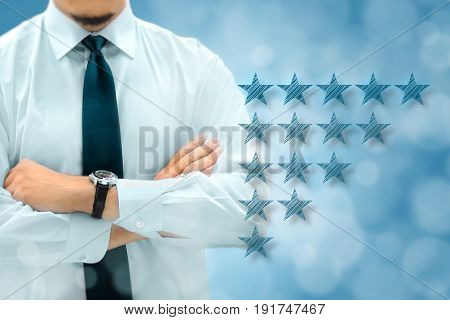 Quality performance review evaluation and classification ranking concept. Businessman silhouette in background. Five yellow glowing stars icons in the foreground.