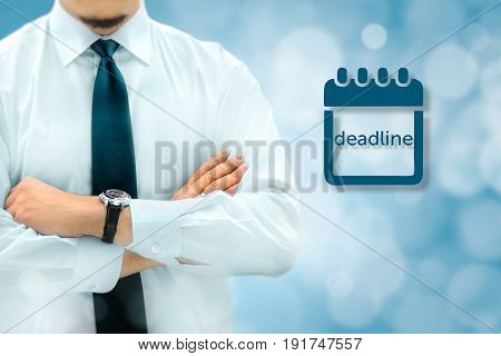 Deadline concept. Businessman silhouette in bacground. Manager thinks about upcoming project deadline.