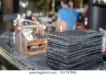 Black graphite sushi slate boards at restaurant