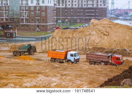 New group of construction building tenement apartment houses, cars on construction yard buildings background