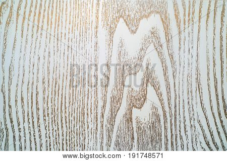 Texture of old board painted with white or cream paint and bronze or golden patina