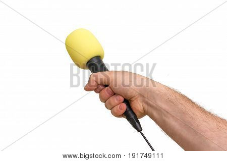 Hand Of Reporter With Yellow Microphone Isolated On White