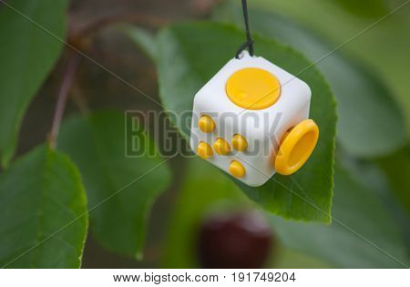 Fidget Cube or Cube antistress in yellow and white color