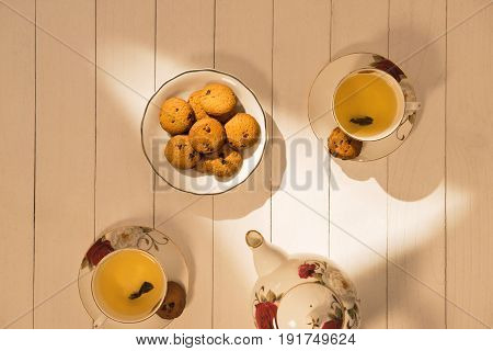 Afternoon Tea Table. Tea Set With Sweet Cakes Or Cookies