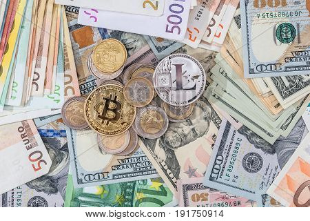 Lite Coin And Bitcoin Above Euro And Dollar Bills