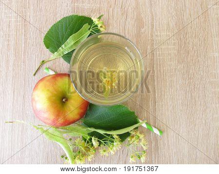Freshly made lemonade with tilia flowers and apple juice