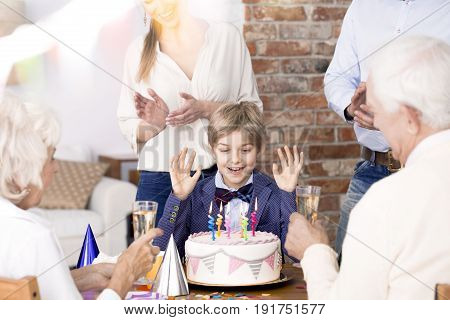 Little boy and his family enjoying birthday party