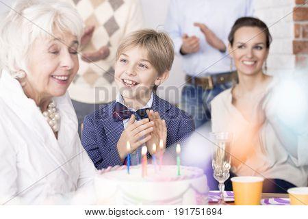 Happy family having fun and celebrating grandma's birthday