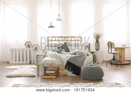 Bright apartment with pallet bed and cable spool table
