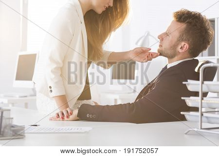 Young woman flirting with colleague in the office