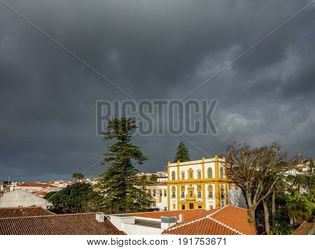 Storm over top of Angra do Heroismo roofs in Azores islands