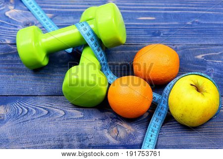 Weight Dumbbells With Measuring Tape, Apple, Orange For Diet Concept