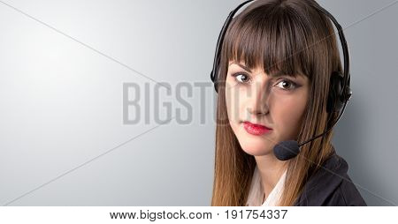 Young female telemarketer on a white background