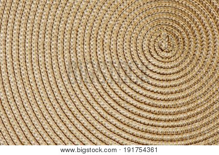 Closeup of a woven straw background. Top view