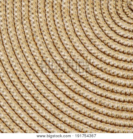 Closeup of a straw woven background. Square crop