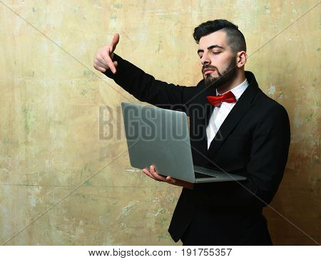 Stylish Bearded Manager With Proud Face Points At Laptop