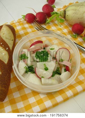 Picnic with radish salad and lye roll