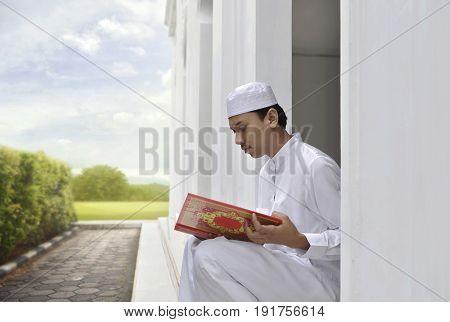 Portrait Of Asian Muslim Man Reading The Koran