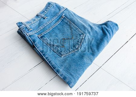 Close up blue thouser jeans isolated on white