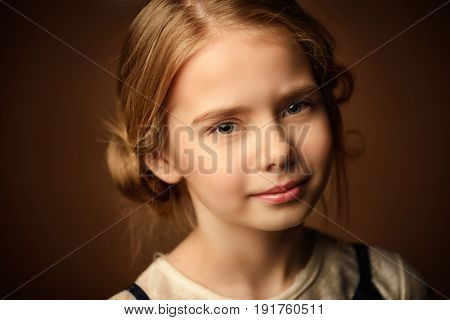 Portrait of a beautiful eight year old girl looking calm and happy. Childhood concept.