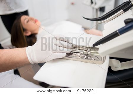Dentist With Gloved Hands Is Treating Patient With Dental Tools In Dental Clinic. Dentistry. Selecti