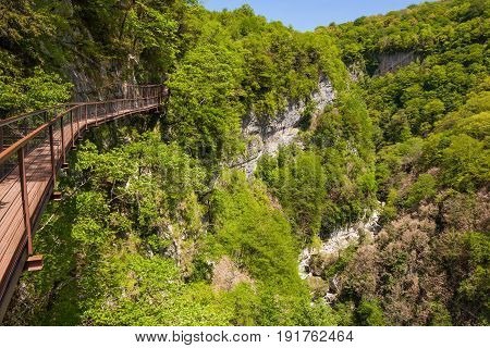 Suspended Road In Canyon Okazio In Mountains Against Blue Sky. Georgia.