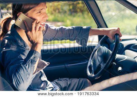 Man Talking On Phone While Driving Car.