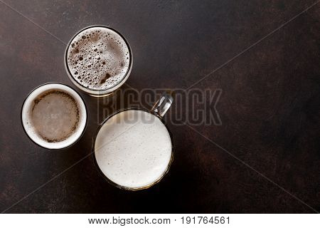 Lager beer mugs on stone table. Top view with copy space