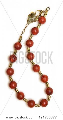 Nice necklace with red beads isolated on white background