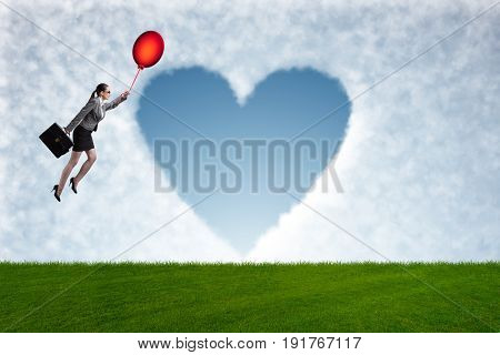 Woman flying balloons in romantic concept