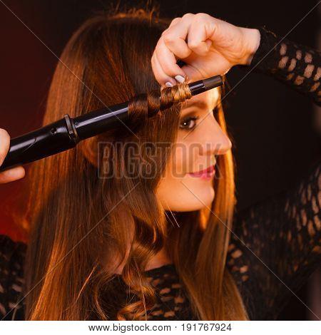 Happy Woman Curling Her Long Brown Hair