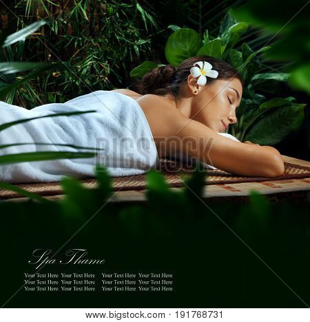 portrait of young beautiful woman in spa environment. banner, space for text.