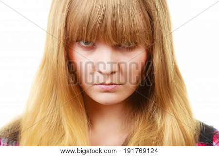 Expressions emotions anger mysterious concept. Angry looking woman face covered in her blonde fringe