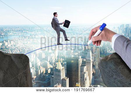 Hand drawing bridge under businessman