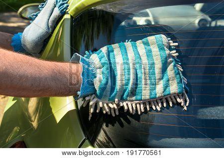 Man Washing His Car - Car Washing And Car Cleaning Concept