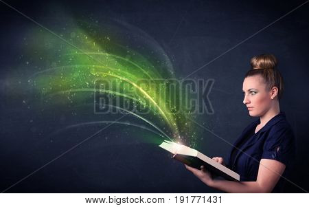 Casual young woman holding book with green wave flying out of it
