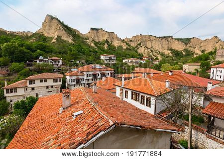 Aerial view with traditional bulgarian houses of Revival period and pyramid mountain rocks in Melnik, Bulgaria
