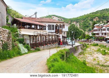 Melnik, Bulgaria - May 11, 2017: Street view with traditional bulgarian houses with terrace from the Revival period in Melnik town, Bulgaria