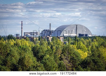 Aerial view of Chernobyl Exclusion Zone Ukraine. Chernobyl New Safe Confinement on background