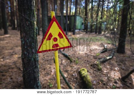 Warning sign in contaminated area of Pripyat city in Chernobyl Exclusion Zone Ukraine
