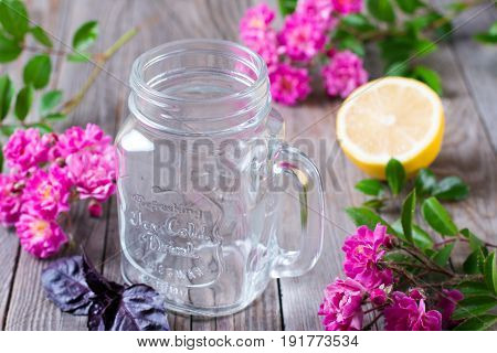 Glass jar for lemonade on a wooden background