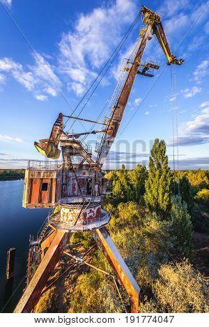Old crane over Yanov Backwater in Chernobyl Exclusion Zone Ukraine