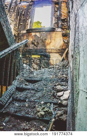 Staircase in the old abandoned burnt house, vertical image