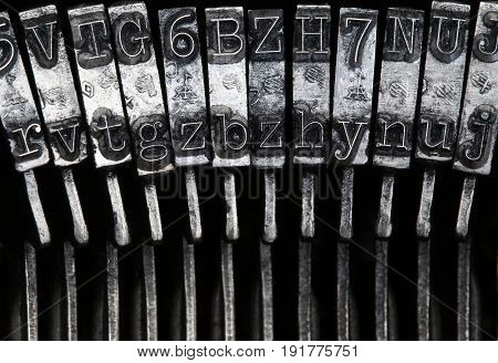 Matrix - letters on old typewriter machine - detail