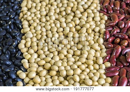 close up red bean black beans and soy bean on wooden table Vegetarian food background and effect filter.