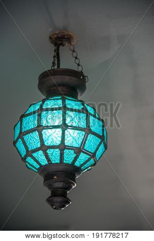 Electronic blue lamp hanging on the ceiling