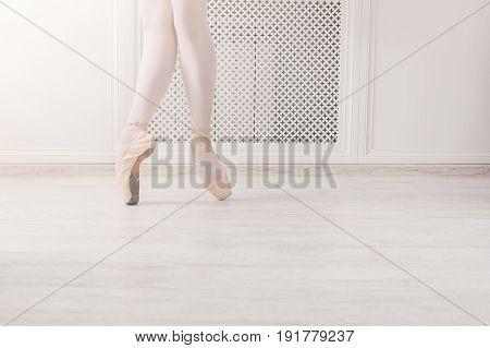 Ballerina graceful legs dance on pointe, ballet dancer concept background